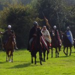 Norman knights led by Bishop Odo of Bayeux, riding under the papal banner